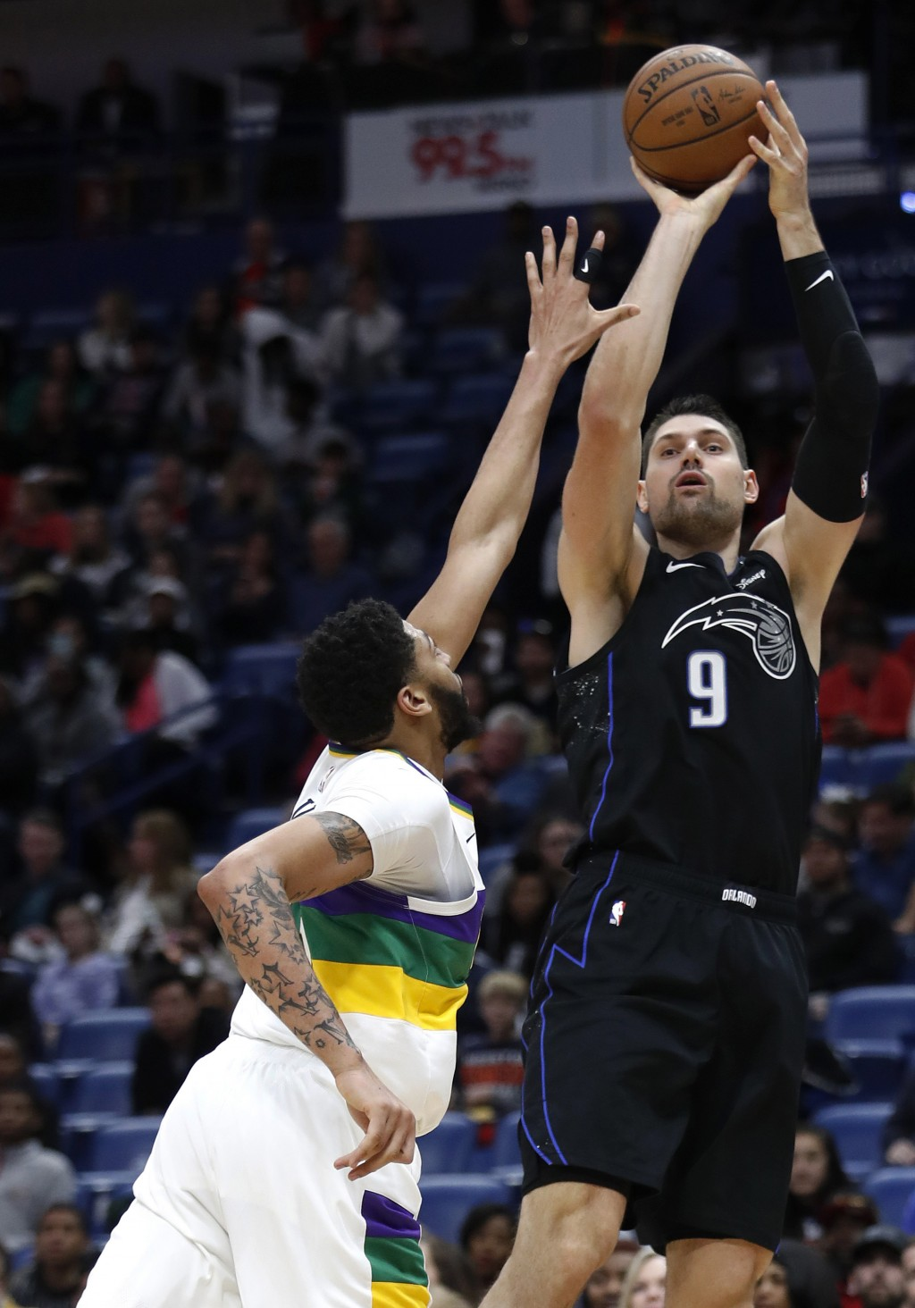 Orlando Magic center Nikola Vucevic (9) shoots over New Orleans Pelicans forward Anthony Davis (23) during the first half of an NBA basketball game in