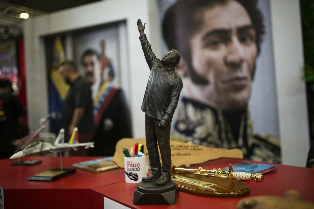 In this Feb. 6, 2019 photo, a statue of Venezuela's late President Hugo Chavez stands on a desk during Diosdado Cabello's weekly, live TV program coin...