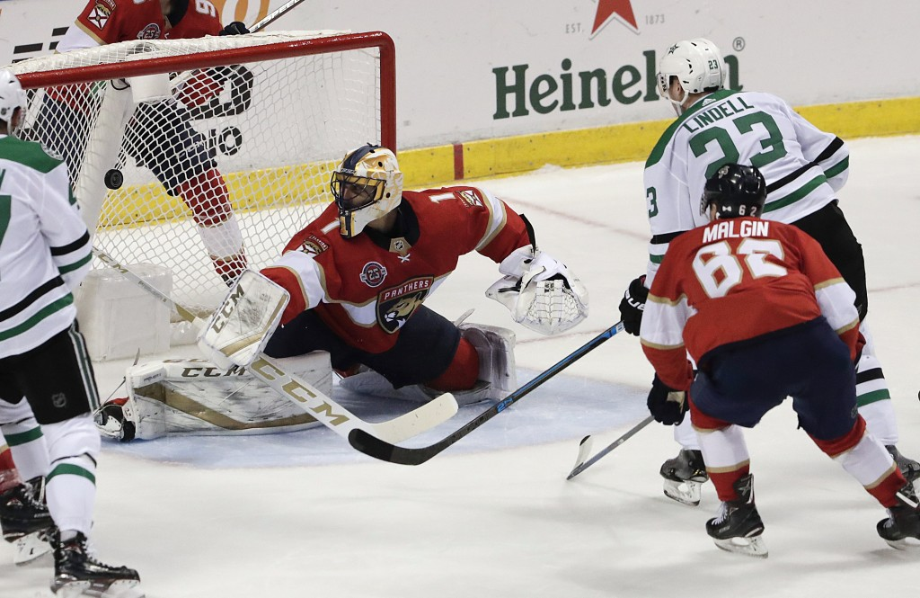 Dallas Stars defenseman Esa Lindell (23) scores against Florida Panthers goaltender Roberto Luongo during the second period of an NHL hockey game, Tue