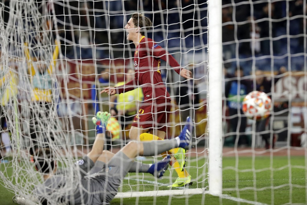 Roma midfielder Nicolo' Zaniolo celebrates after scoring his side's second goal during a Champions League round of 16 first leg soccer match between R