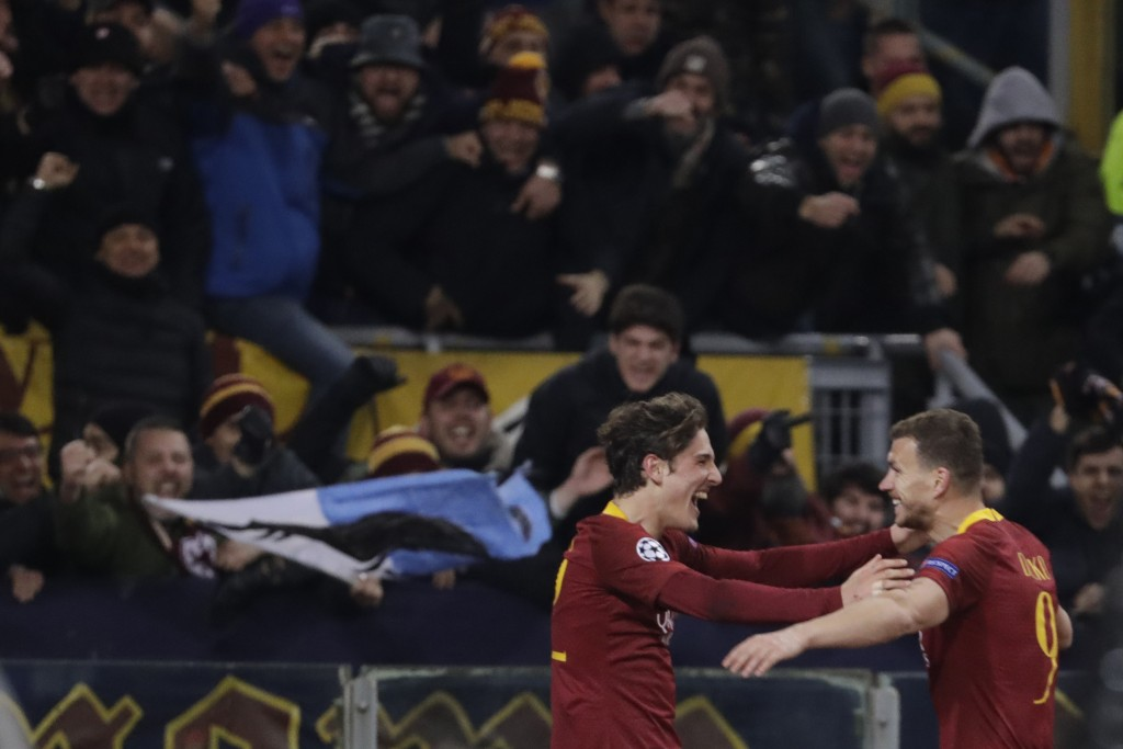 Roma midfielder Nicolo' Zaniolo, left, celebrates after scoring his side's second goal with his teammate Edin Dzeko during a Champions League round of...