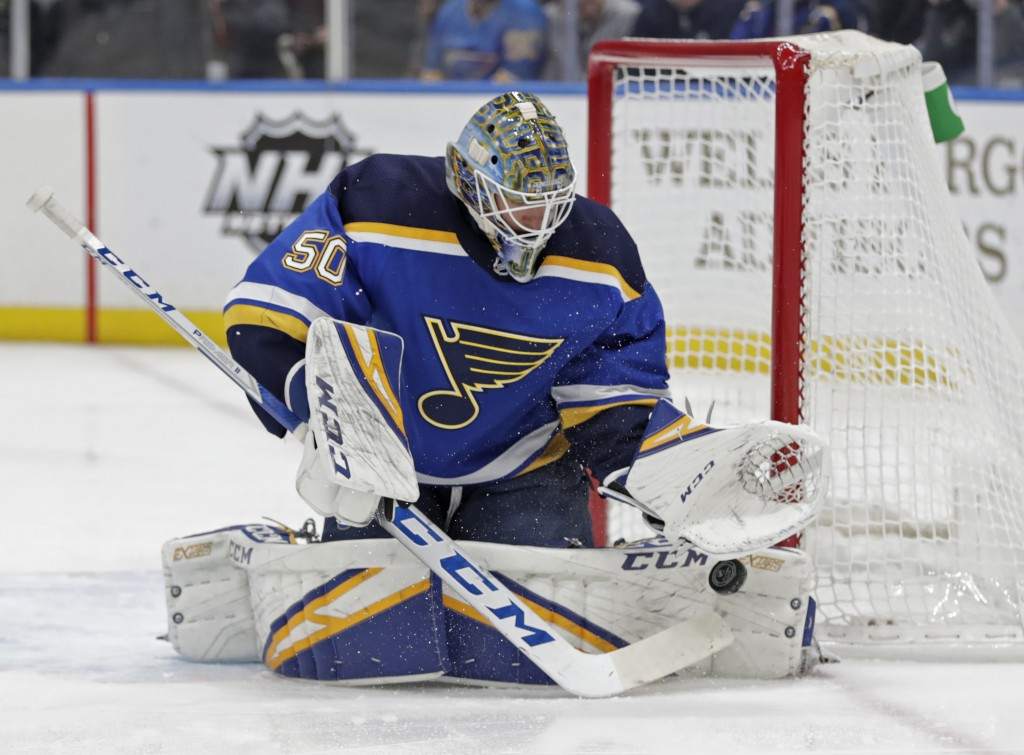 St. Louis Blues goaltender Jordan Binnington (50) makes a save in the first period of an NHL hockey game against the New Jersey Devils, Tuesday, Feb. ...