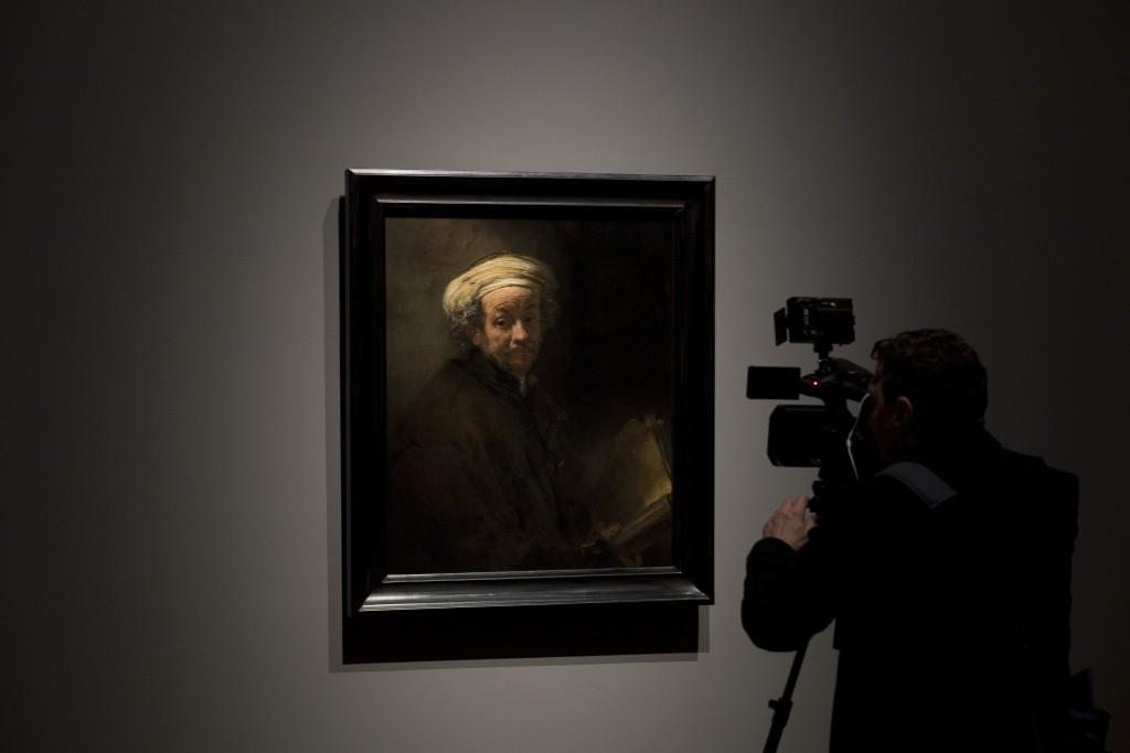"""A cameraman takes images of Rembrandt's """"self-portrait as the Apostle Paul"""" (oil on canvas, 1661) during a press preview of an exhibition of the all t..."""