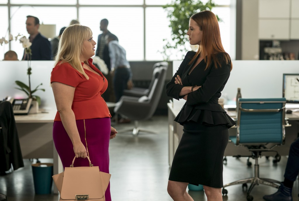 "This image released by Warner Bros. Pictures shows Rebel Wilson, left, and Betty Gilpin in a scene from ""Isn't It Romantic."" (Michael Parmelee/Warner ..."