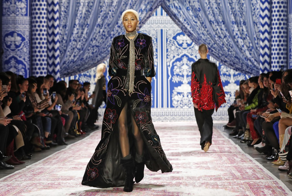 The latest fashion from Naeem Khan is modeled during Fashion Week Tuesday, Feb. 12, 2019, in New York. (AP Photo/Kathy Willens)