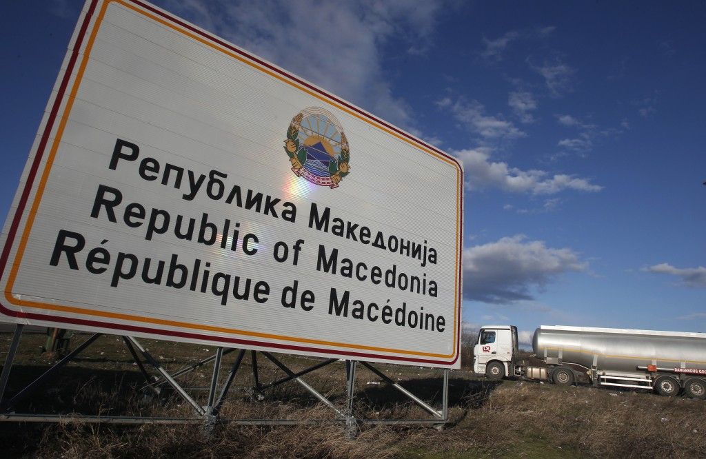 """A tank truck drives by a road sign reading """"Republic of Macedonia"""" entering from Greece into Macedonia at Bogorodica border crossing, on Macedonia's s"""
