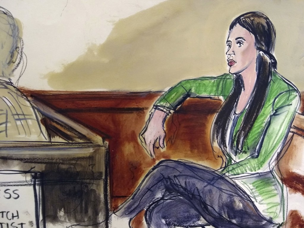 """In this courtroom drawing, Emma Coronel Aispuro, wife of Mexican drug kingpin Joaquin """"El Chapo"""" Guzman, sits in the gallery listening, via earphones,..."""