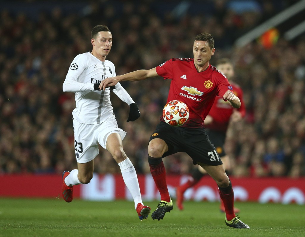 Manchester United's Nemanja Matic, right vies for the ball with Paris Saint Germain's Julian Draxler during the Champions League round of 16 soccer ma...
