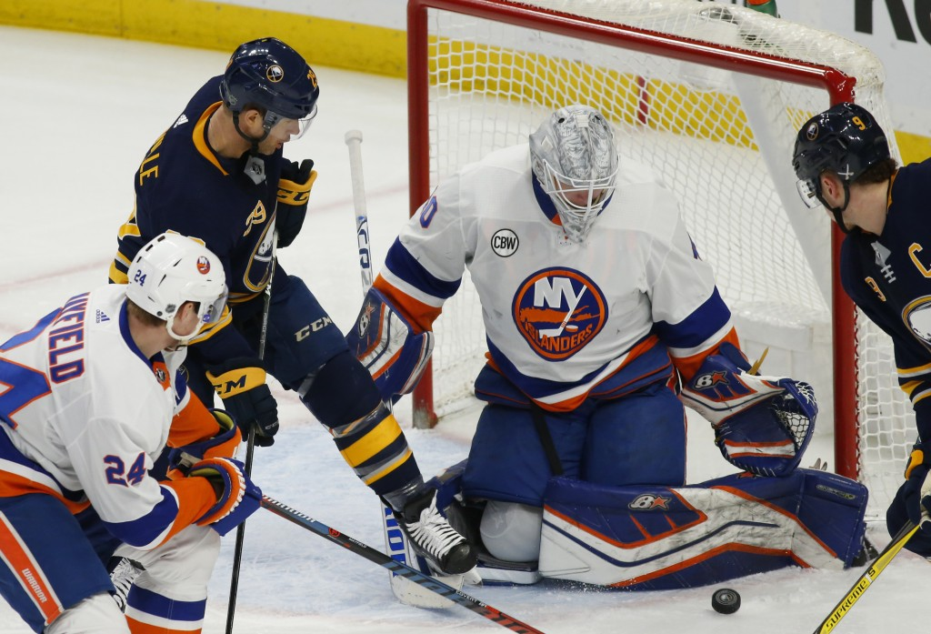 Buffalo Sabres forward Jason Pominville (29) is stopped by New York Islanders goalie Robin Lehner (40) during the first period of an NHL hockey game, ...