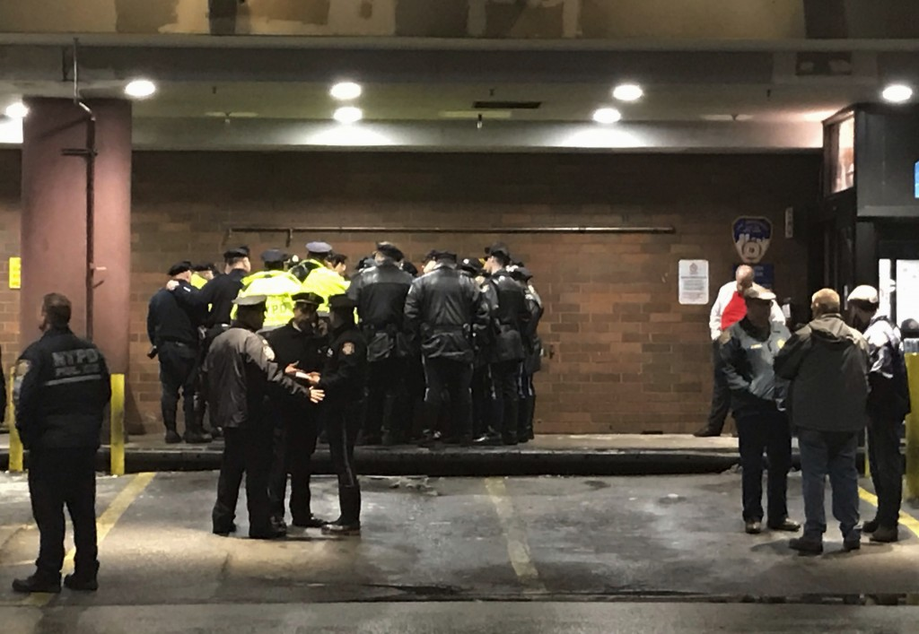 New York City police officers gather at Jamaica Hospital in the Queens borough of New York after a few NYPD officers while responding to a robbery in ...