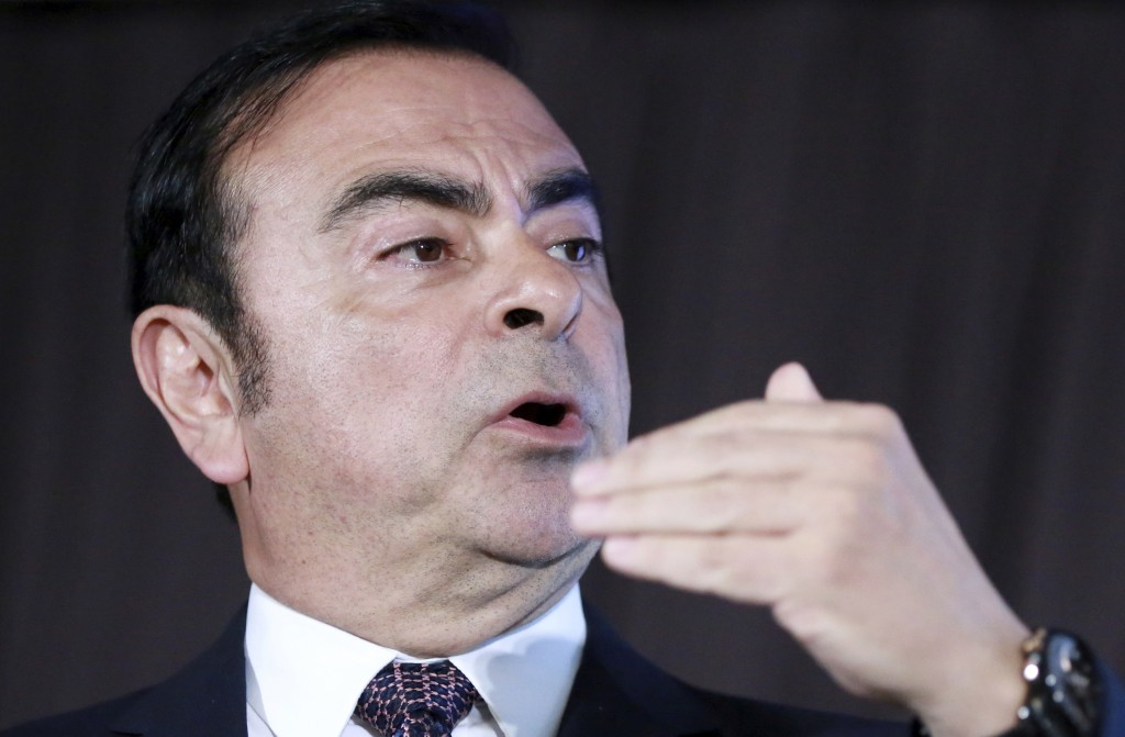 In this May 12, 2016, photo, then Nissan Motor Co. President and CEO Carlos Ghosn speaks during a press conference in Yokohama, near Tokyo. Motonari O...