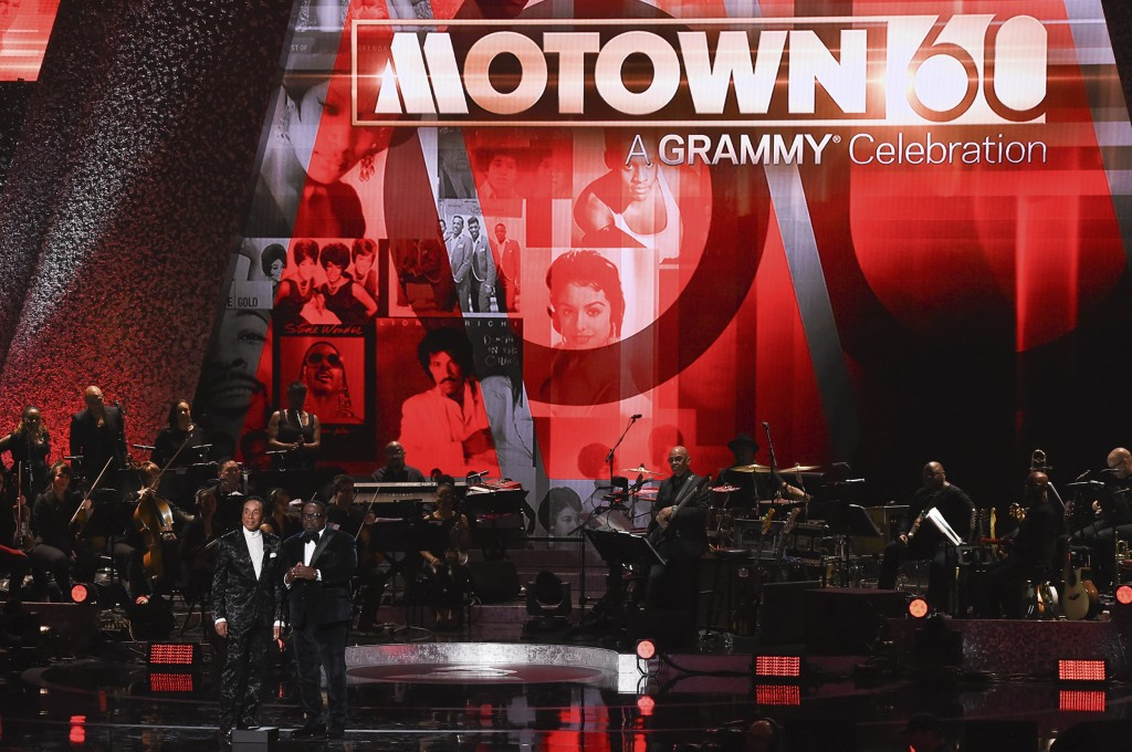 Smokey Robinson, left, and Cedric the Entertainer speak onstage during Motown 60: A GRAMMY Celebration at the Microsoft Theater on Tuesday, Feb.12, 20