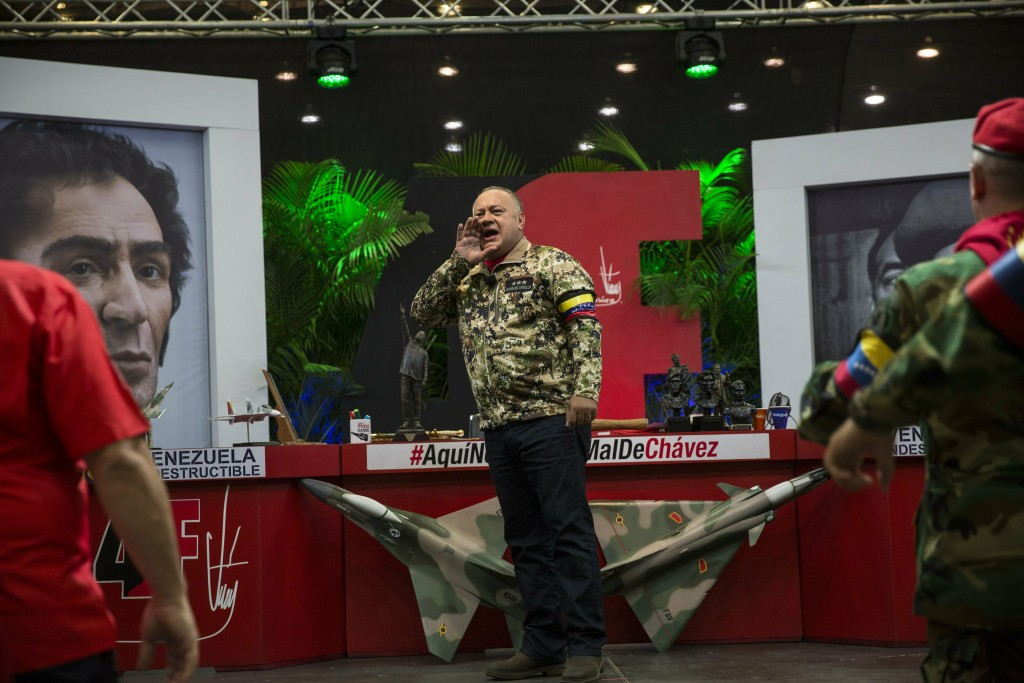 In this Feb. 6, 2019 photo, Diosdado Cabello, president of the ruling party-dominated constitutional assembly, chants pro-government slogans during hi...