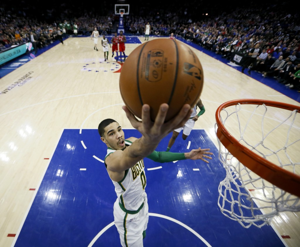 Boston Celtics' Jayson Tatum goes up for a shot during the first half of an NBA basketball game against the Philadelphia 76ers, Tuesday, Feb. 12, 2019