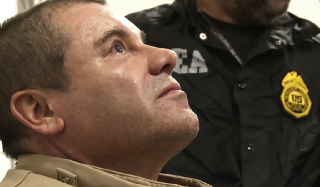 """In this Jan. 19, 2017 photo provided by the United States Drug Enforcement Administration, Mexican drug kingpin Joaquin """"El Chapo"""" Guzman arrives at L..."""