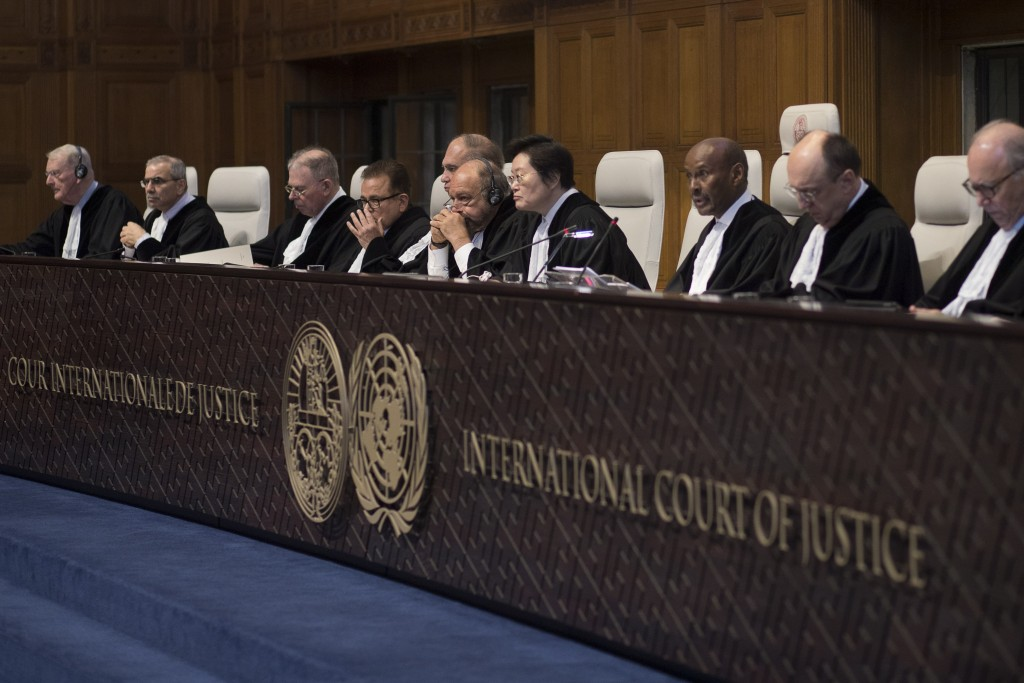 Presiding judge Abdulqawi Ahmed Yusuf of Somalia, third from right, reads the court's verdict as delegations of Iran and the U.S. listen at the Intern
