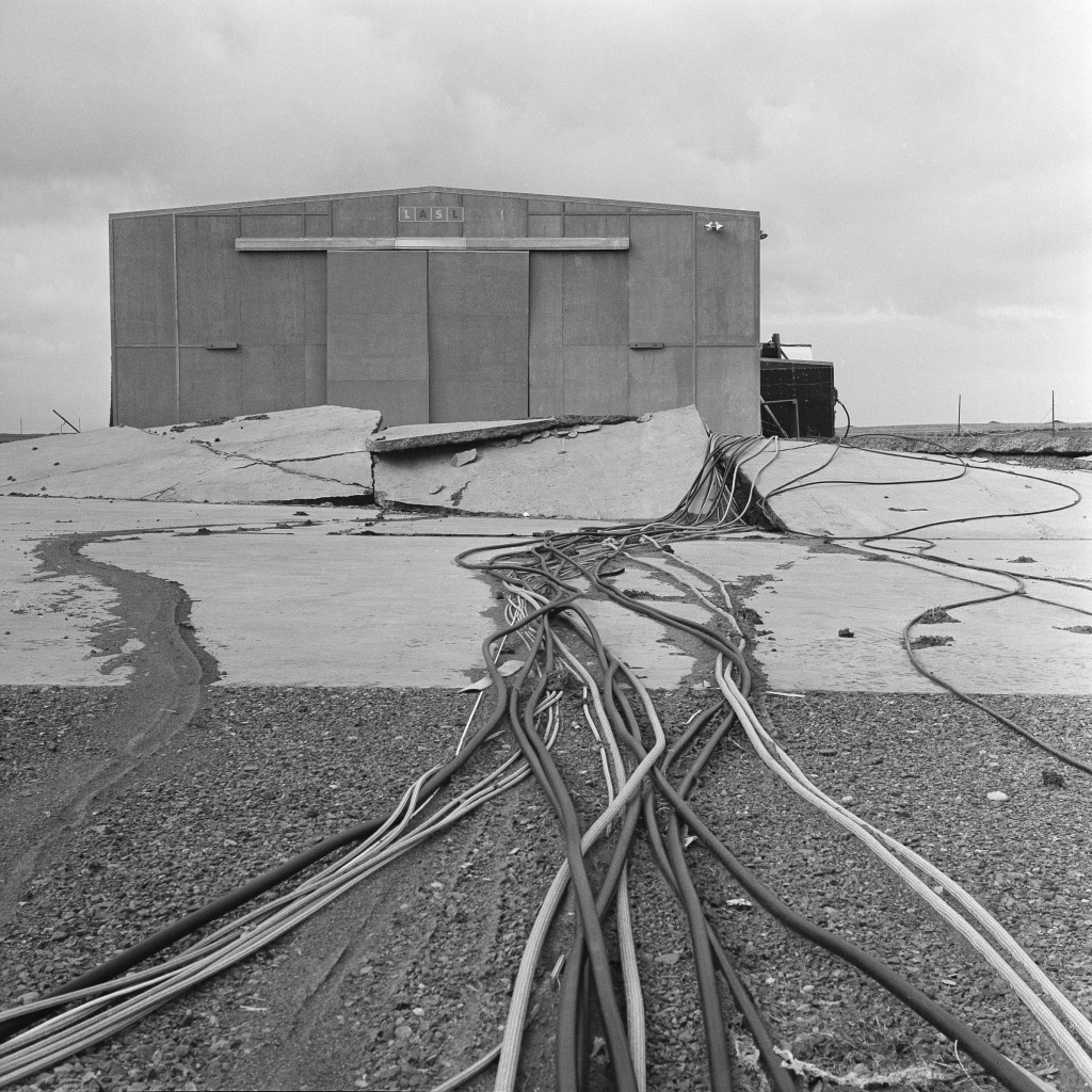 """FILE - This file photo from June of 1971 shows a buckled cement pad that was damaged from the 1 megaton nuclear blast """"Milrow"""", detonated 4,000 feet u"""