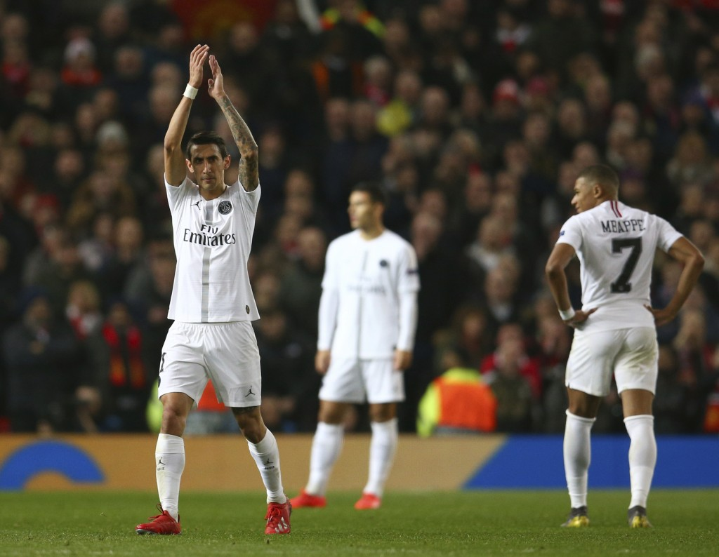 Paris Saint Germain's Angel Di Maria applauds his teams fans as he is substituted during the Champions League round of 16 soccer match between Manches...