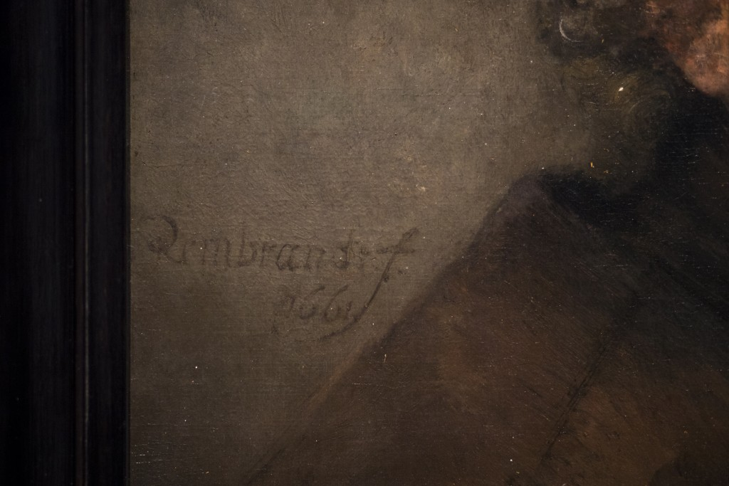 "Detail of Rembrandt's ""self-portrait as the Apostle Paul"" (oil on canvas, 1661) with his signature seen center left, right next to the frame, during a"