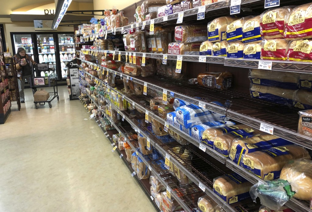 FILE- This Feb. 7, 2019, file photo shows the bread section of a Safeway store in Tacoma, Wash. On Wednesday, Feb. 13, 2019, the Labor Department repo...