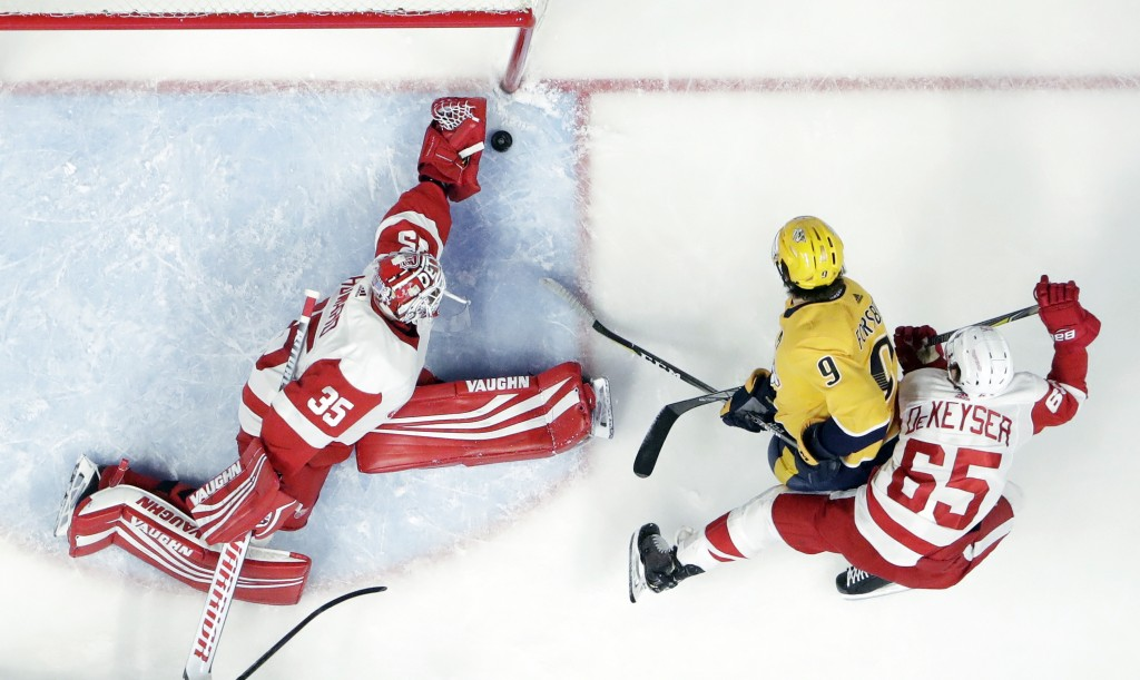 Detroit Red Wings goaltender Jimmy Howard (35) makes a stop on a shot by Nashville Predators left wing Filip Forsberg (9), of Sweden, during the first