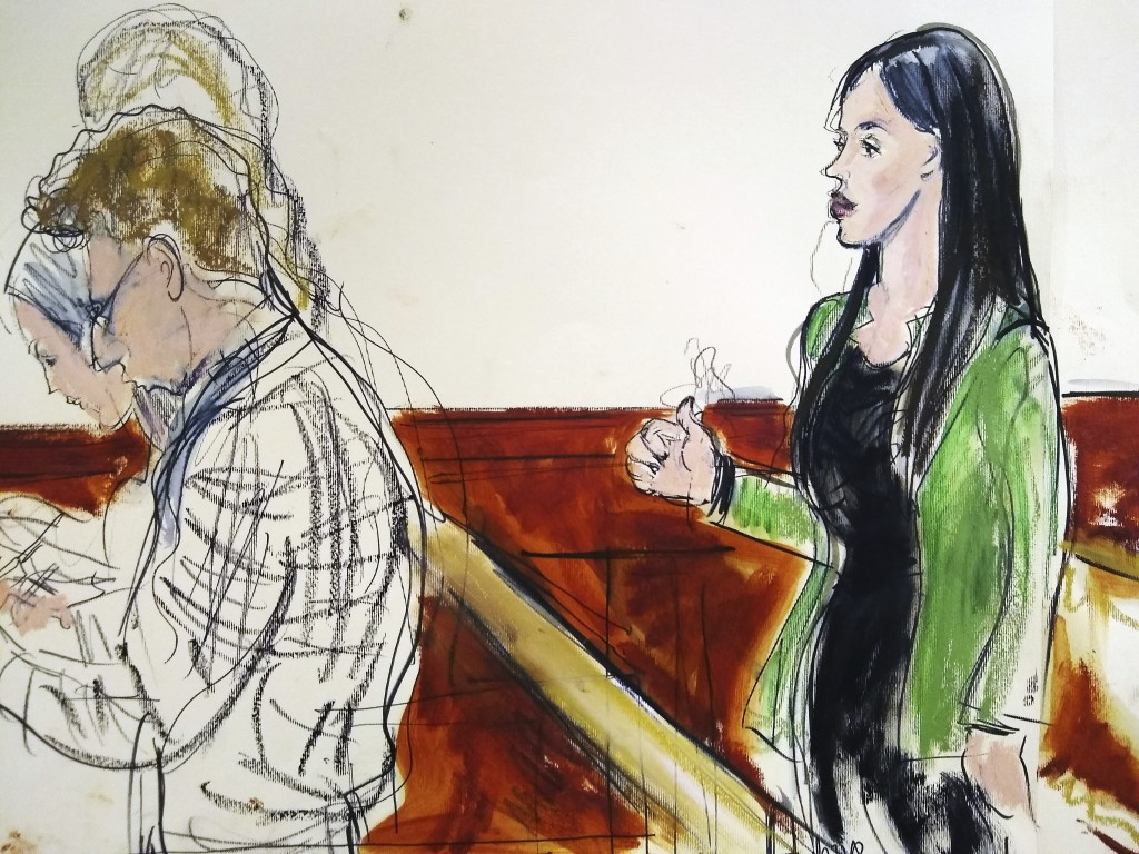 "In this courtroom drawing, Emma Coronel Aispuro, right, wife of Mexican drug kingpin Joaquin ""El Chapo"" Guzman, reacts, Tuesday, Feb. 12, 2019, after"