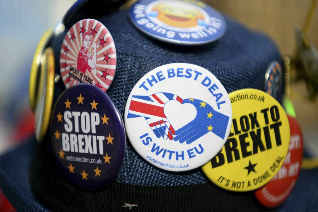 Detail of badges on an anti-Brexit protestor's hat during protests outside Britain's parliament in London, Wednesday Feb. 13, 2019. British Prime Mini...
