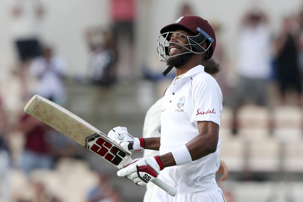 West Indies' Roston Chase celebrates after he scored a century against England during day four of the third cricket Test match at the Daren Sammy Cric