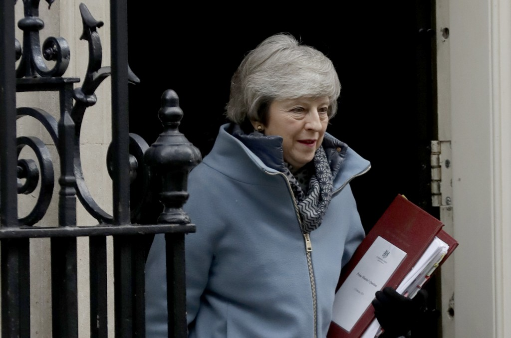 British Prime Minister Theresa May leaves 10 Downing Street in London, to attend Prime Minister's Questions at the Houses of Parliament, Wednesday, Fe...