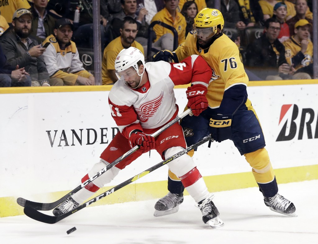 Detroit Red Wings center Luke Glendening (41) is defended by Nashville Predators' P.K. Subban (76) during the first period of an NHL hockey game Tuesd