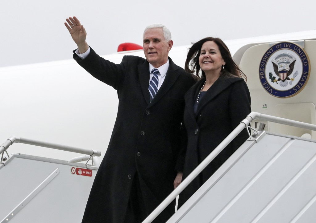United States Vice President Mike Pence and his wife Karen Pence arrive at the airport in Warsaw, Poland, Wednesday, Feb. 13, 2019. The Polish capital...
