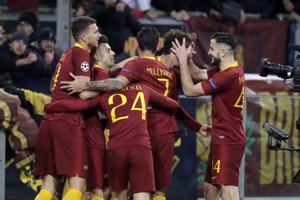 Roma players celebrate the second goal of their team during a Champions League round of 16 first leg soccer match between Roma and Porto, at Rome's Ol