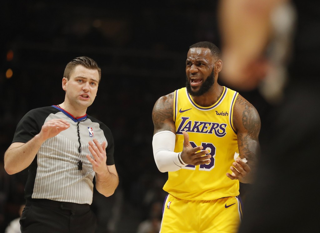 Los Angeles Lakers forward LeBron James (23) argues with an official during the first half of an NBA basketball game against the Atlanta Hawks Tuesday...