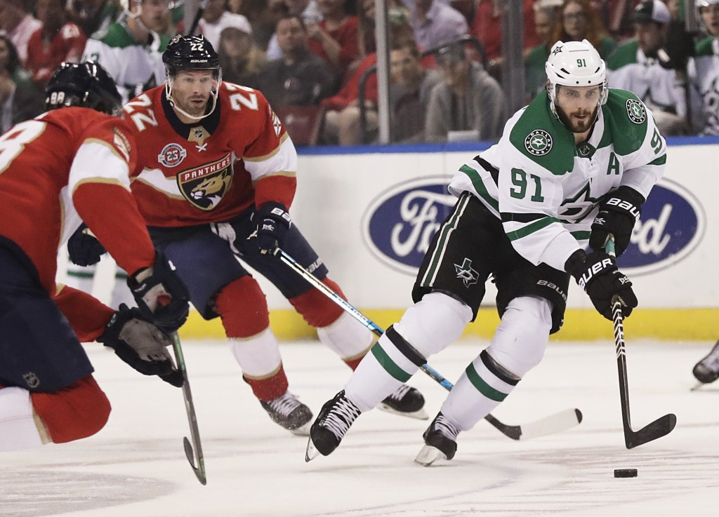 Dallas Stars center Tyler Seguin (91) and Florida Panthers right wing Troy Brouwer (22) battle for the puck during the first period of an NHL hockey g