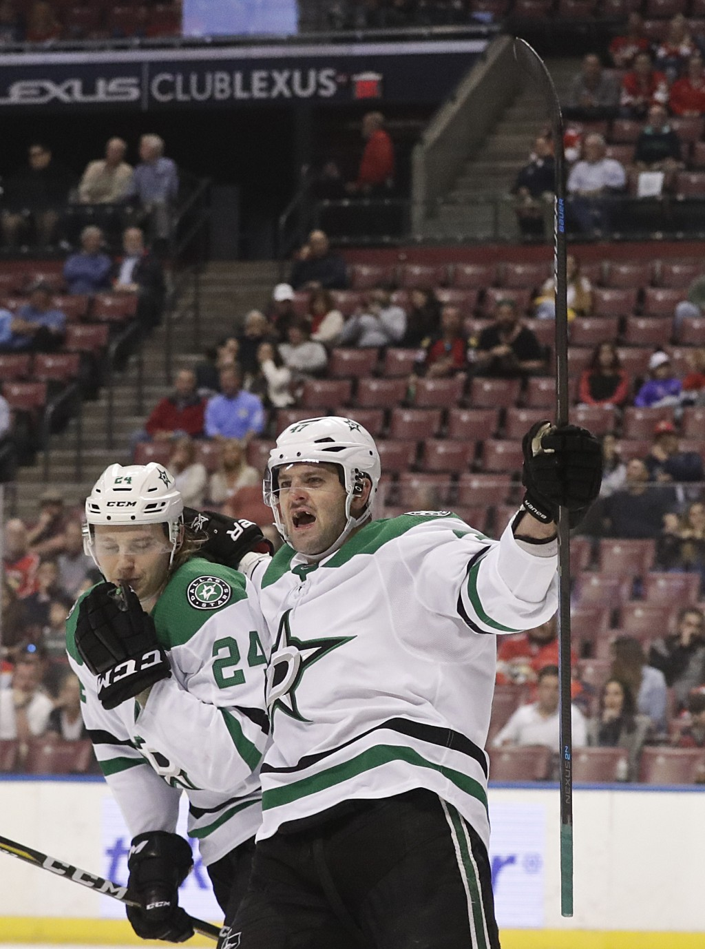 Dallas Stars right wing Alexander Radulov, right, and left wing Roope Hintz celebrate a goal by Dallas Stars center Tyler Seguin during the first peri...