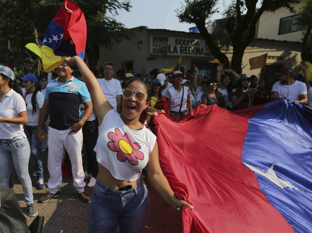 A woman shouts slogans against Venezuela's President Nicolas Maduro during a protest against his government in Urena, Venezuela, Tuesday, Feb. 12, 201...