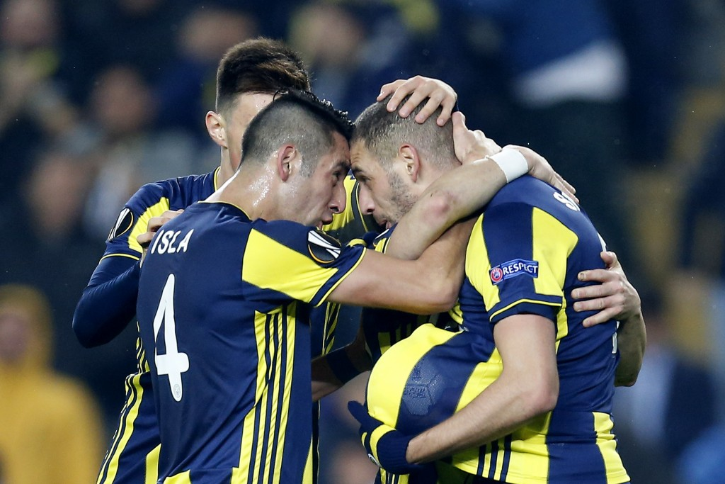 Fenerbahce players celebrate their goal against Zenit St. Petersburg during the Europa League round of 32 soccer match between Fenerbahce and Zenit, i...