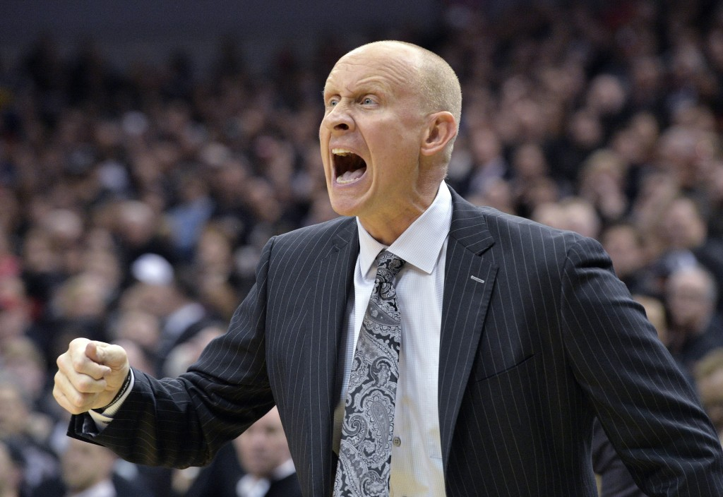 Louisville coach Chris Mack argues a call during the first half of an NCAA college basketball game against Duke in Louisville, Ky., Tuesday, Feb. 12,