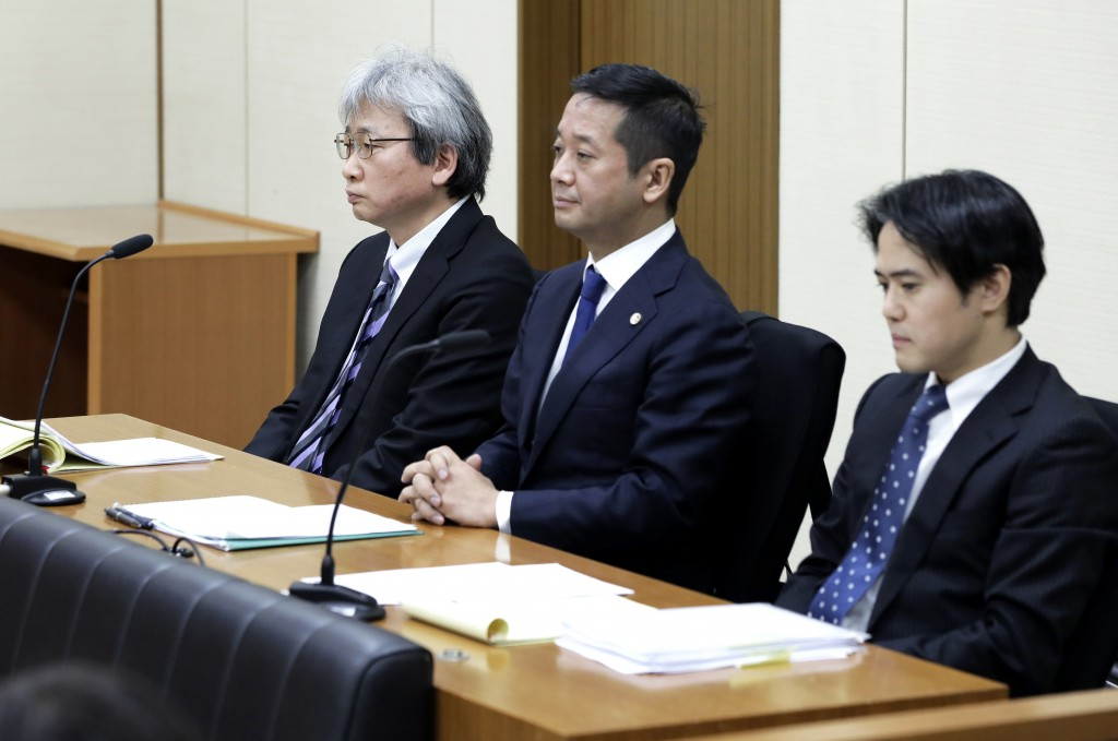 FILE - In this Jan. 8, 2019, file photo, Motonari Ohtsuru, left, chief lawyer of the legal team for former Nissan chairman Carlos Ghosn, other members...