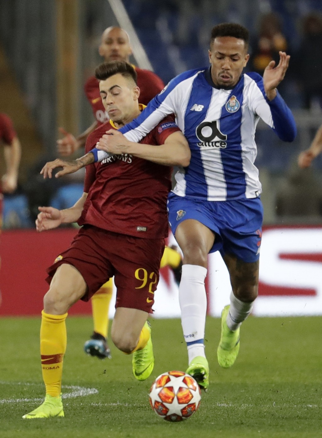 Porto defender Eder Militao, right, and Roma forward Stephan El Shaarawy fight for the ball during a Champions League round of 16 first leg soccer mat...