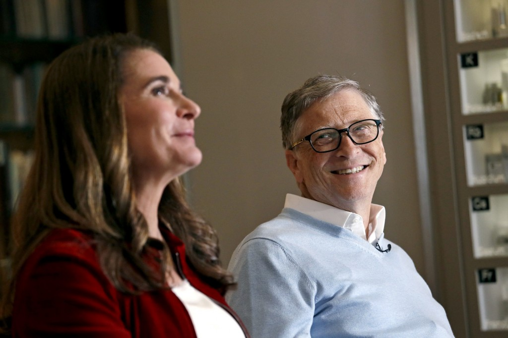 In this Feb. 1, 2019 photo, Bill Gates looks to his wife Melinda as they are interviewed in Kirkland, Wash. The couple, whose foundation has the large