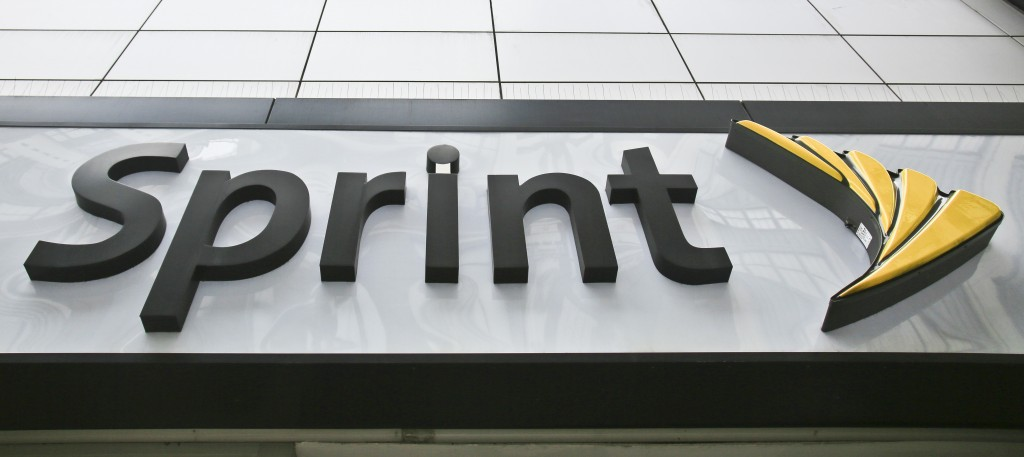 FILE - This April 30, 2018, file photo shows signage for a Sprint store in New York's Herald Square. The top executives of T-Mobile and Sprint are mak...