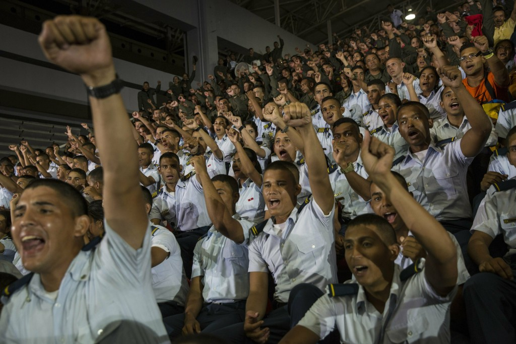 """In this Feb. 6, 2019 photo, air force cadets chant pro-government slogans during Diosdado Cabello's weekly, live TV program coined: """"Con el Mazo Dando"""