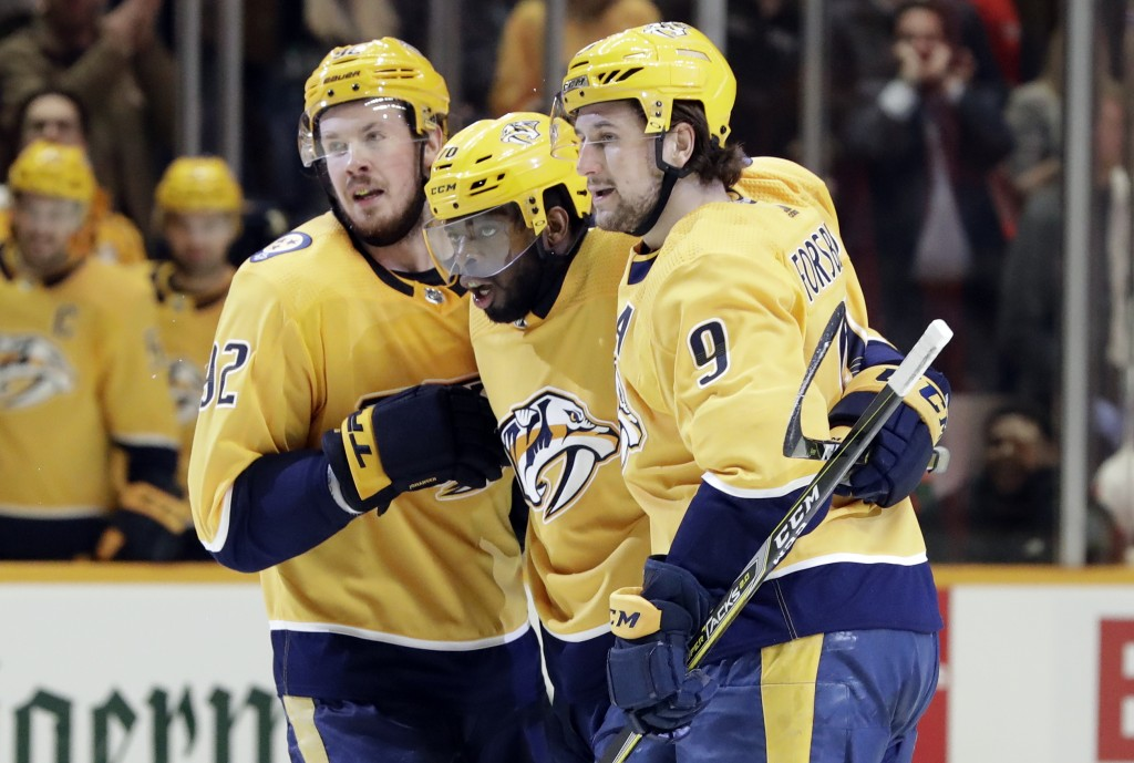 Nashville Predators defenseman P.K. Subban, center, celebrates with Ryan Johansen (92) and Filip Forsberg (9), of Sweden, after Subban scored against