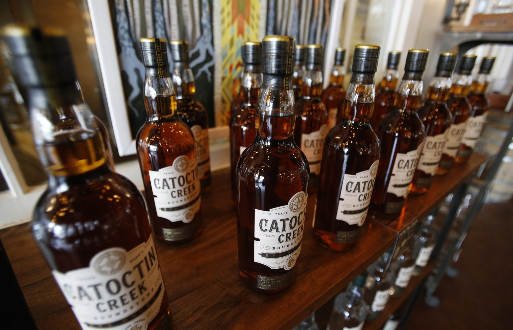 FILE - In this June 20, 2018 file photo, Catoctin Creek Distillery whiskey is on display in a tasting room in Purcellville, Va.  Retaliatory tariffs c