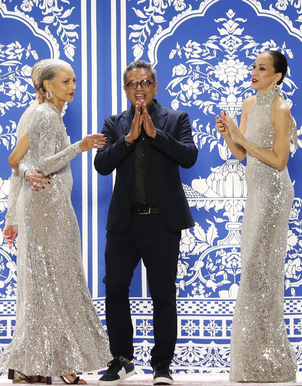 Fashion designer Naeem Khan appears on the runway after presenting his latest fashion creations during New York Fashion Week, Tuesday, Feb. 12, 2019, ...