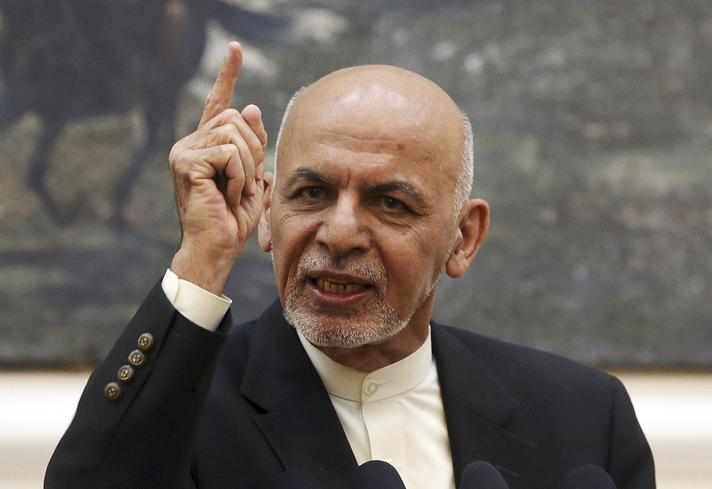 FILE - In this July 15, 2018, file photo, Afghan President Ashraf Ghani speaks during a press conference at the presidential palace in Kabul, Afghanis...