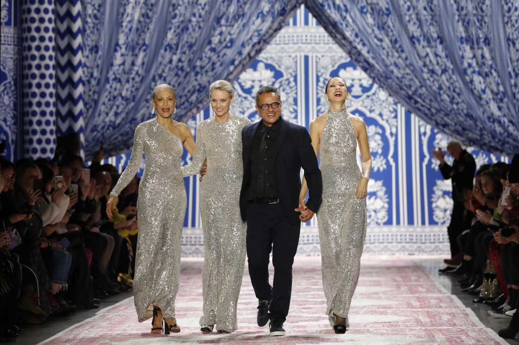 ADDS MODELS' NAMES - Fashion designer Naeem Khan, third from left, walks the runway with models Alva Chinn, left, Karen Bjornson and Pat Cleveland fro