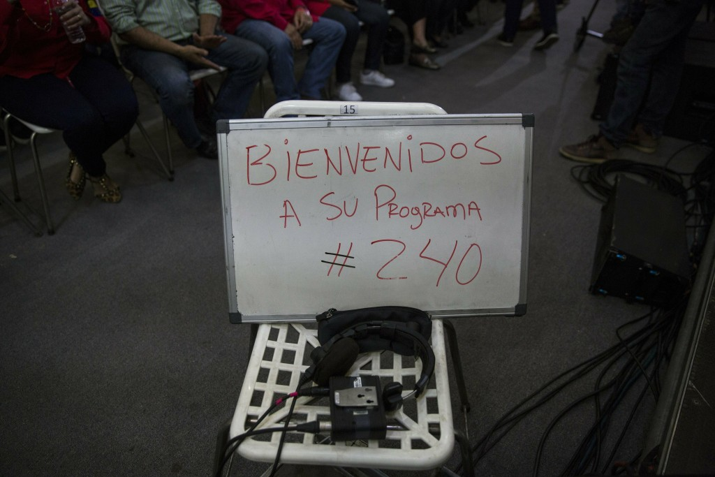 """In this Feb. 6, 2019 photo, a whiteboard with a note that reads in Spanish: """"Welcome to program 240"""" is displayed minutes before the start of the week"""