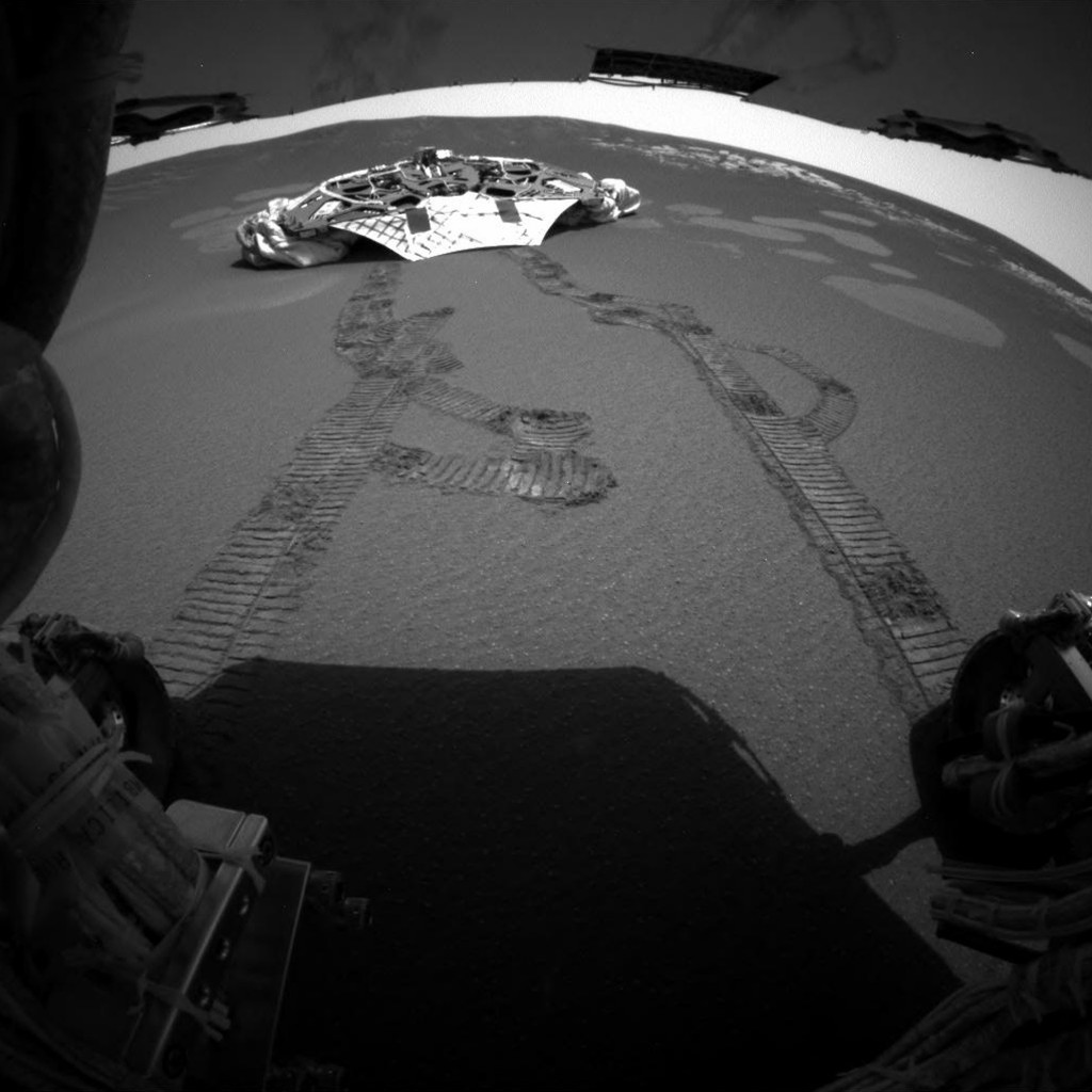 FILE - This photo released Thursday, Feb. 5, 2004 made by one of the rear hazard-avoidance cameras on NASA's Opportunity rover, shows Opportunity's la...